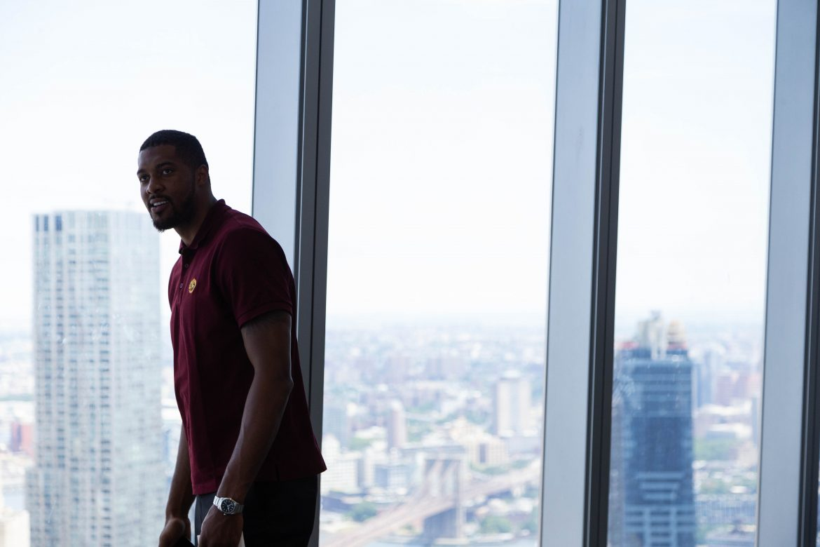 Derrick Favors taking in the view from the sales gallery for 125 Greenwich at One World Trade.